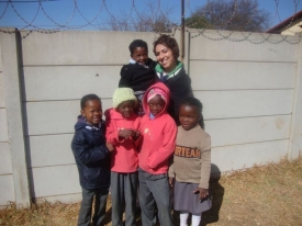 Mindra Kelly with Group of Children